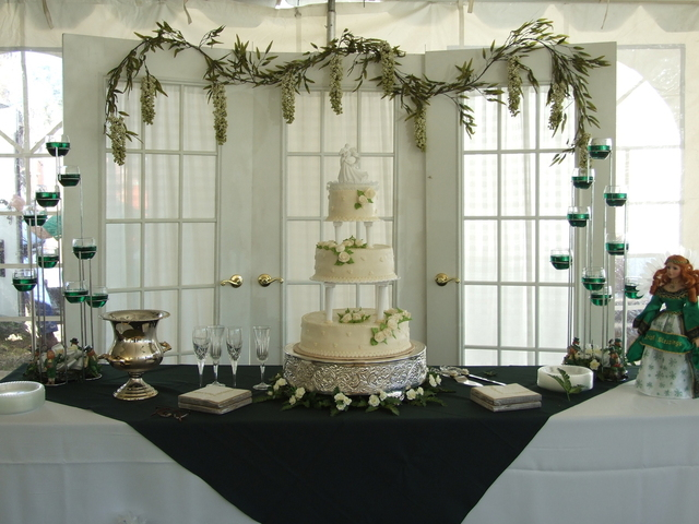 a wedding cake prepared to be cut